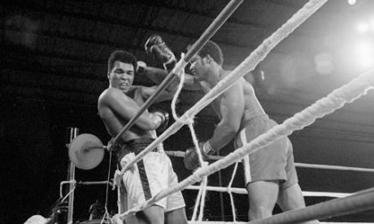 Muhammad Ali soaks up George Foreman's punches on the ropes in Zaire in the Rumble in the Jungle